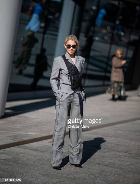 Caroline Caro Daur is seen wearing grey suit outside Sportmax on Day 3 Milan Fashion Week Autumn/Winter 2019/20 on February 22 2019 in Milan Italy