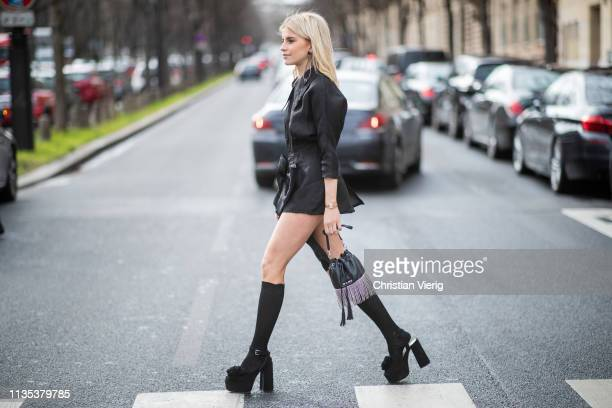 Caroline Caro Daur is seen wearing Miu Miu bag, black asymmetric bag, knee socks outside Miu Miu during Paris Fashion Week Womenswear Fall/Winter...