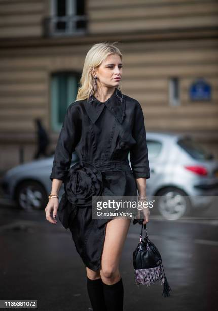 Caroline Caro Daur is seen wearing Miu Miu bag black asymmetric bag knee socks outside Miu Miu during Paris Fashion Week Womenswear Fall/Winter...