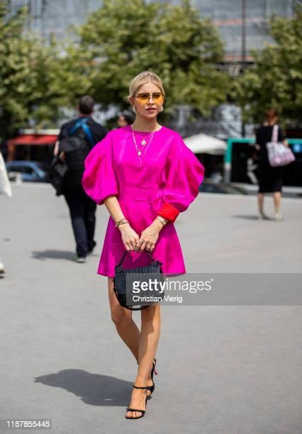 Caroline Caro Daur is seen wearing pink dress outside Kenzo during Paris Fashion Week Menswear Spring/Summer 2020 on June 23 2019 in Paris France