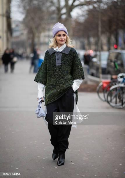 Caroline Caro Daur is seen wearing purple Acne beanie green jacket outside Acne during Paris Fashion Week Menswear F/W 20192020 Day Six on January 20...