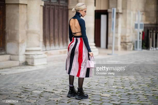 Caroline Caro Daur is seen wearing turtleneck, striped skirt, sheer tights outside Thom Browne during Paris Fashion Week Womenswear Fall/Winter...