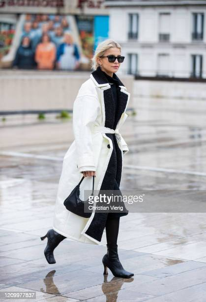 Caroline Caro Daur is seen wearing white coat Prada bag outside Y/Project during Paris Fashion Week Womenswear Fall/Winter 2020/2021 Day Eight on...