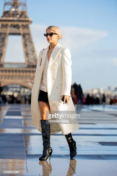 Caroline Caro Daur is seen wearing white coat red bag black mini skirt boots outside Rochas during Paris Fashion Week Womenswear Fall/Winter...