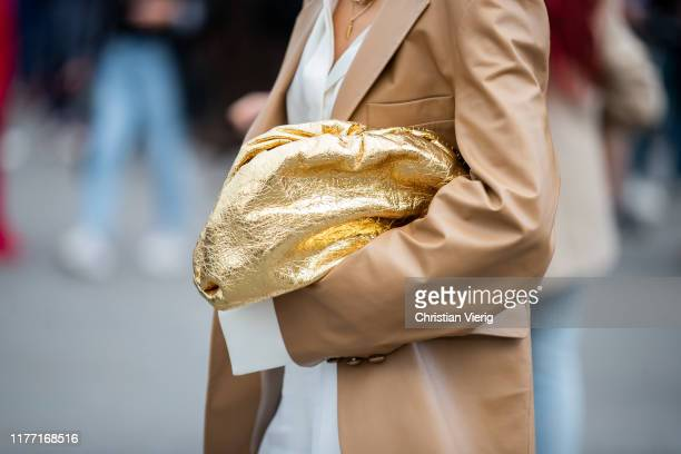 Caroline Caro Daur seen wearing beige jacket, white high waist pants, sandals, golden Bottega Veneta pouch outside Rochas during Paris Fashion Week...