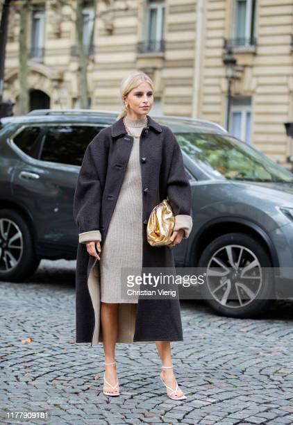 Caroline Caro Daur seen wearing beige knited dress, black coat, golden Bottega Veneta pouch bag outside Altuzarra during Paris Fashion Week...