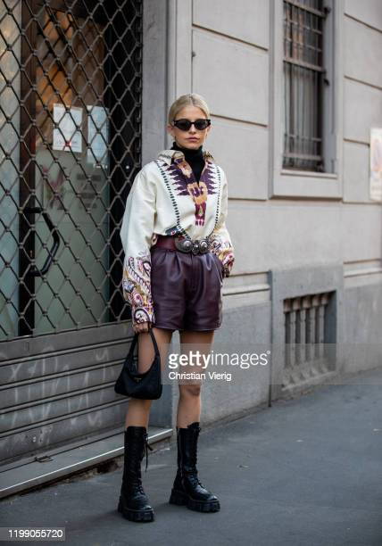 Caroline Caro Daur seen wearing black boots Prada bag bordeaux shorts top with print outside Etro during Milan Fashion Week Fall/Winter 2020/2021 on...