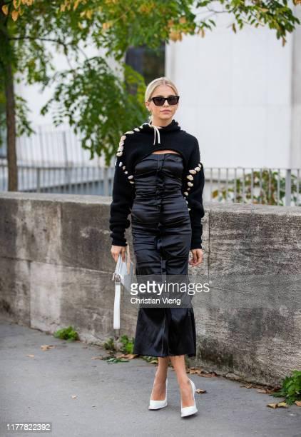 Caroline Caro Daur seen wearing black dress cropped knit outside Haider Ackermann during Paris Fashion Week Womenswear Spring Summer 2020 on...