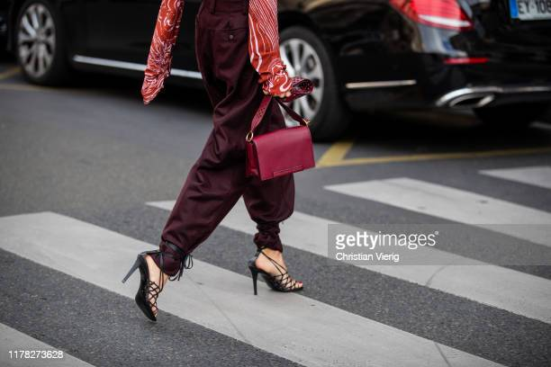 Caroline Caro Daur seen wearing bordeaux turtleneck, pants, and bag, laced heels outside Stella McCartney during Paris Fashion Week Womenswear Spring...