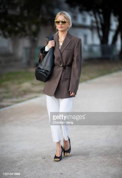 Caroline Caro Daur seen wearing brown blazer black Bottega Veneta bag white pants outside Alexandre Vauthier during Paris Fashion Week Haute Couture...