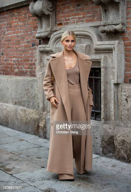 Caroline Caro Daur seen wearing brown coat outside Max Mara during the Milan Women's Fashion Week on September 24, 2020 in Milan, Italy.