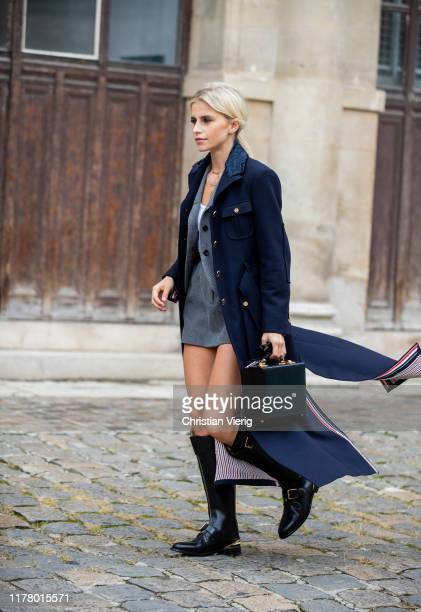 Caroline Caro Daur seen wearing navy coat with slits black bag boots grey dress blazer outside Thom Browne during Paris Fashion Week Womenswear...