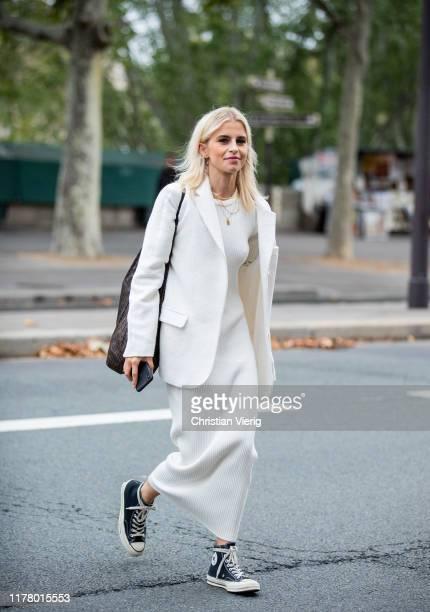 Caroline Caro Daur seen wearing white dress, blazer during Paris Fashion Week Womenswear Spring Summer 2020 on September 29, 2019 in Paris, France.