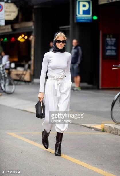 Caroline Caro Daur seen wearing white pants head scarf outside the Max Mara show during Milan Fashion Week Spring/Summer 2020 on September 19 2019 in...