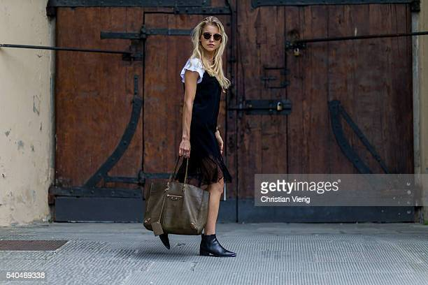 Caroline Caro Daur wearing a Marina Harpe dress white Filippa K thsirt an olive Balenciaga bag Acne shoes and round Ray Ban sunglasses during Pitti...