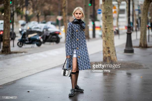 Caroline Caro Daur wearing coat with slit, Prada knee socks, bag is seen outside Elie Saab during Paris Fashion Week Womenswear Fall/Winter 2019/2020...