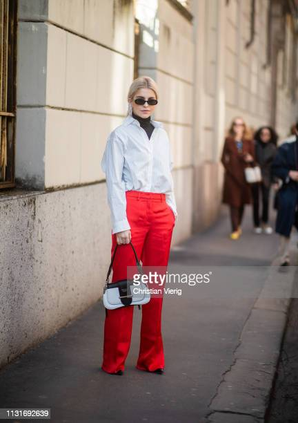 Caroline Caro Daur wearing red pants Prada bag is seen outside Etro on Day 3 Milan Fashion Week Autumn/Winter 2019/20 on February 22 2019 in Milan...