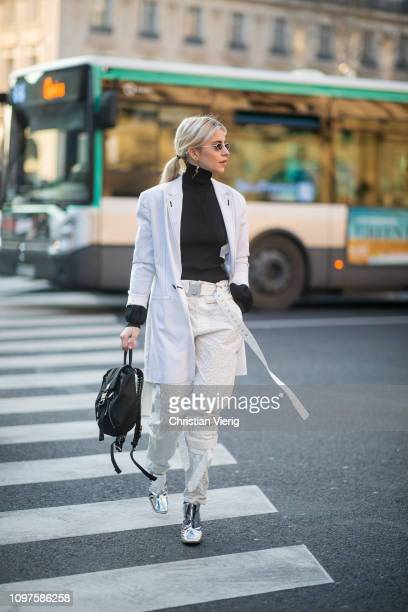 Caroline 'Caro' Daur wearing white pants white jacket black turtleneck is seen outside Schiaparelli during Paris Fashion Week Haute Couture Spring...