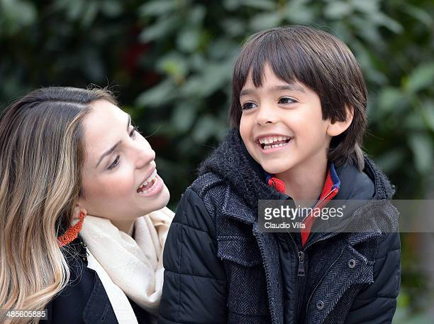 Caroline Celico and Luca Kaka attend the Serie A match between AC Milan and AS Livorno Calcio at San Siro Stadium on April 19, 2014 in Milan, Italy.