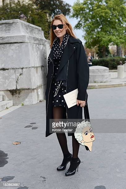 Caroline Christiansson fashion editor at French Glamour wearing Salvatore Ferragamo shoes Louis Vuitton jacket Hermes scarf Yaz Bukey bag Marc by...