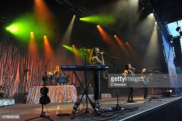 Caroline Corr Sharon Corr Andrea Corr and Jim Corr of The Corrs perform on stage during Kew The Music at Kew Gardens on July 16 2016 in London England