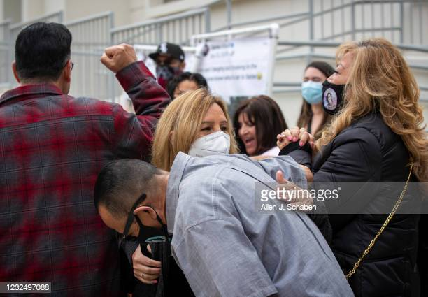 Caroline Crespin, right, mother of Monique Munoz, is hugged by family, friends and supporters during a protest outside the Inglewood Juvenile...