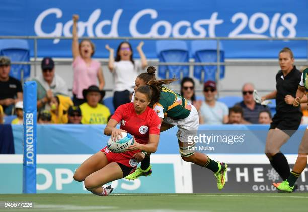 Caroline Crossley of Canada dives over to score the opening try during the Rugby Sevens Women's Pool A match between Canada and South Africa on day...