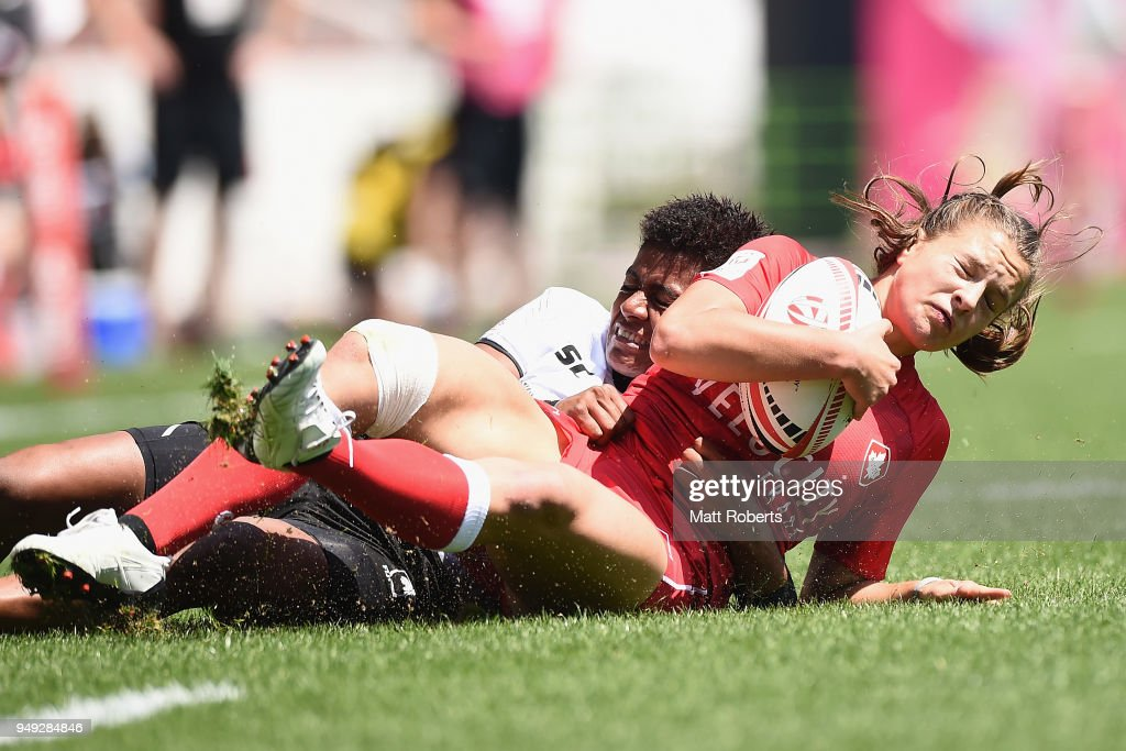 Caroline Crossley of Canada is tackled by Miriama Naiobasali of Fiji on day one of the HSBC Women's Rugby Sevens Kitakyushu Pool match between Canada and Fiji at Mikuni World Stadium Kitakyushu on April 21, 2018 in Kitakyushu, Fukuoka, Japan.