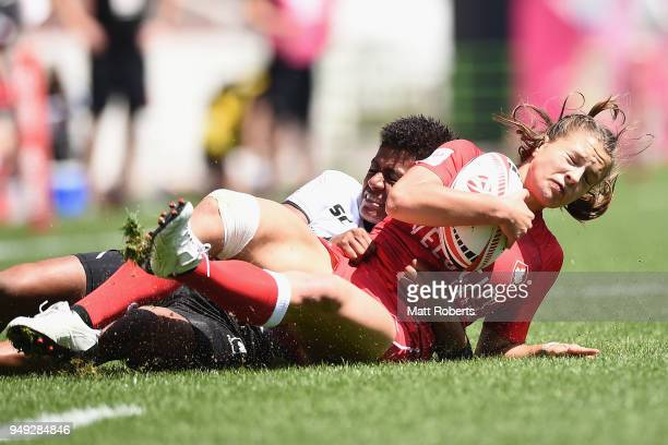 Caroline Crossley of Canada is tackled by Miriama Naiobasali of Fiji on day one of the HSBC Women's Rugby Sevens Kitakyushu Pool match between Canada...