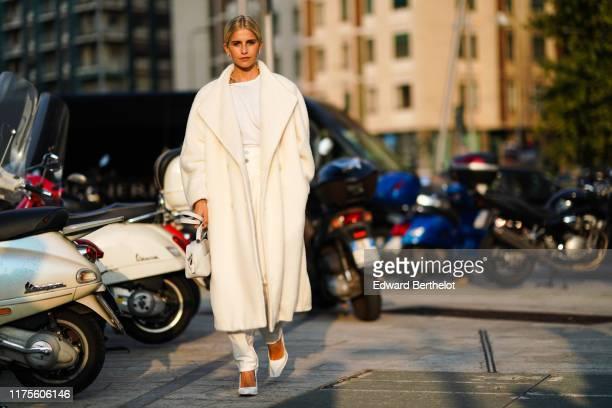Caroline Daur a white coat a white bag a white tshirt pants heels shoes outside the Alberta Ferretti show during Milan Fashion Week Spring/Summer...