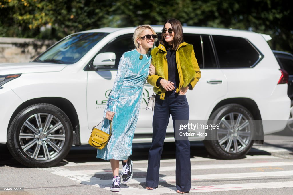 Caroline Daur and Camila Coelho in front of a Lexus seen in the streets of Manhattan outside Tory Burch during New York Fashion Week on September 8, 2017 in New York City.