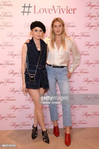 Caroline Daur and Camille Charriere attend Roger Vivier '#LoveVivier' Book Launch Cocktail on May 24 2018 in Paris France
