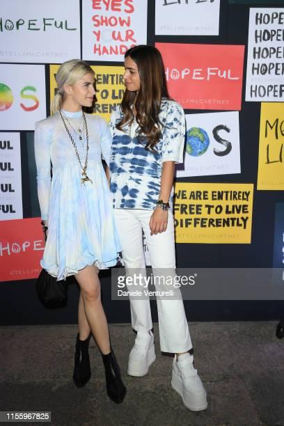 Caroline Daur and model attend the presentation of Stella McCartney during the Milan Men's Fashion Week Spring/Summer 2020 on June 14 2019 in Milan...