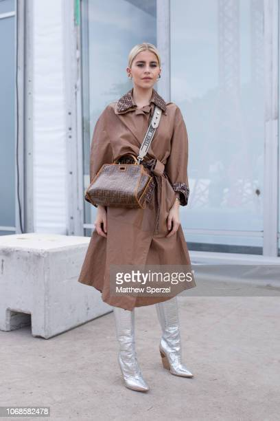 Caroline Daur is seen on the street attending Design Miami Preview Day during Miami Art Week wearing Fendi coat and bag with silver boots on December...