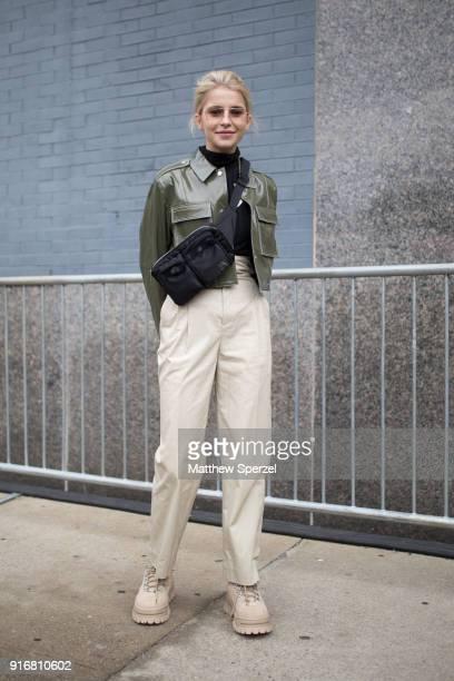 Caroline Daur is seen on the street attending Dion Lee during New York Fashion Week wearing an army green jacket khaki pants and black crossbody bag...