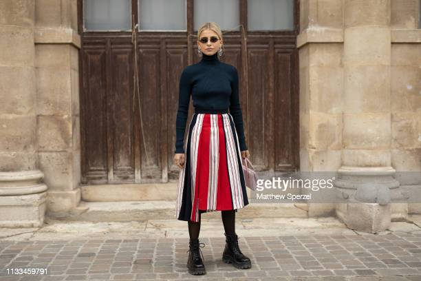 Caroline Daur is seen on the street attending THOM BROWNE during Paris Fashion Week AW19 wearing THOM BROWNE navy sweater with red/white skirt on...