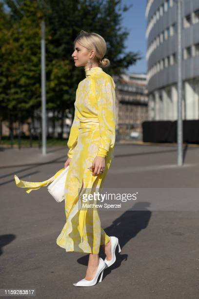Caroline Daur is seen on the street during Paris Haute Couture Fashion Week wearing Acne Studios yellow dress with white heels on June 30, 2019 in...