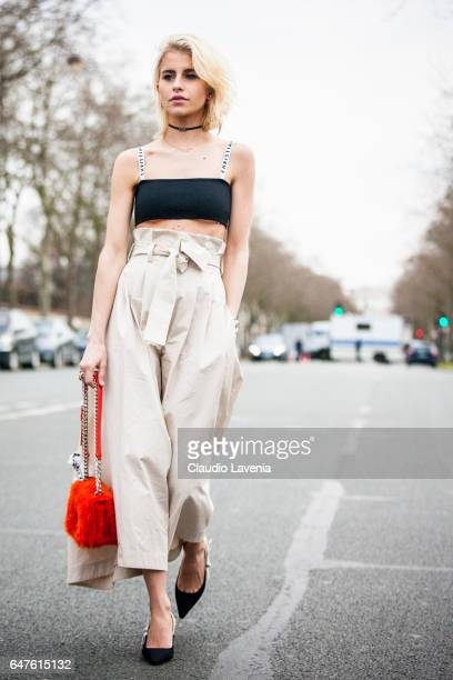 Caroline Daur is seen wearing a dress from Dior in the streets of Paris after the Christian Dior show during Paris Fashion Week Womenswear...