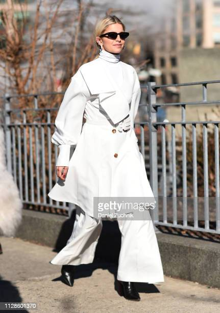Caroline Daur is seen wearing a white coat white sweater and white pants outside the Adeam show during New York Fashion Week Fall/Winter 2019 on...