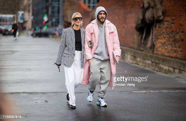 Caroline Daur is seen wearing white pants grey blazer and Marc Goehring wearing grey jogger pants outside Balmain during Paris Fashion Week...