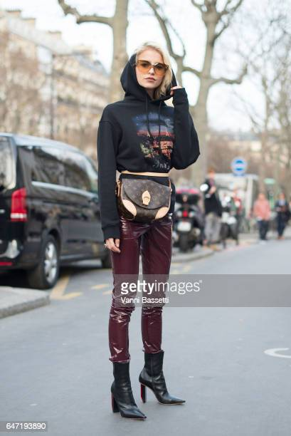 Caroline Daur poses wearing a Balenciaga hoodie Louis Vuitton bag and Isabel Marant pants before the Rick Owens show at the Palais de Tokyo during...