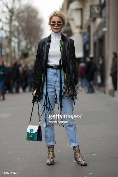 Caroline Daur poses wearing a fringed leather jacket after the Elie Saab show at the Pavillion Cambon during Paris Fashion Week Haute Couture Spring...