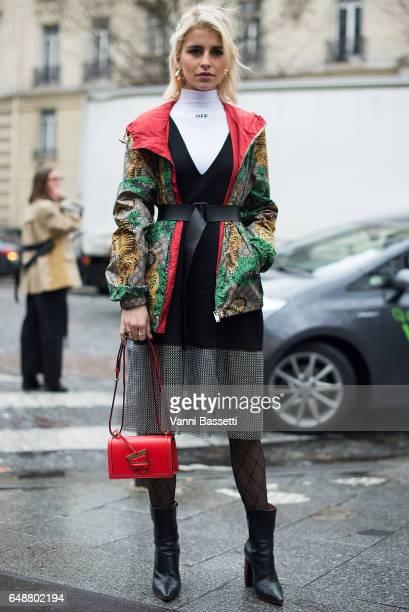 Caroline Daur poses wearing a Gucci windbreaker and Loewe bag after the Giambattista Valli show at the Hotel Potocki during Paris Fashion Week...