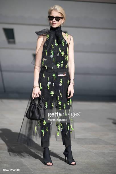 Caroline Daur poses wearing Prada after the Giambattista Valli show at the Palais des Congres during Paris Fashion Week SS19 Womenswear on October 1...