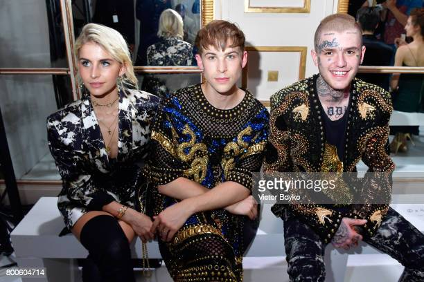 Caroline Daur Tommy Dorfman and Lil Peep attend the Balmain Menswear Spring/Summer 2018 show as part of Paris Fashion Week on June 24 2017 in Paris...