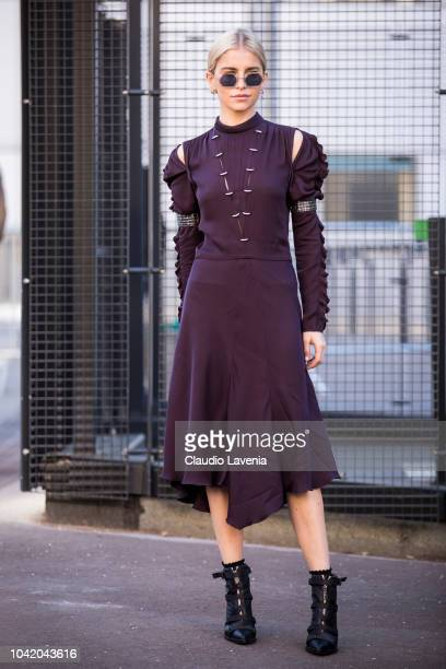 Caroline Daur, wearing a burgundy, midi dress and black heels, is seen before the Chloe show on September 27, 2018 in Paris, France.