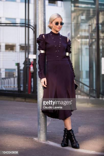 Caroline Daur wearing a burgundy midi dress and black heels is seen before the Chloe show on September 27 2018 in Paris France