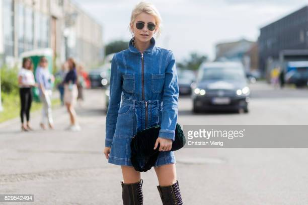 Caroline Daur wearing a denim dress overknees outside Ganni on August 10 2017 in Copenhagen Denmark