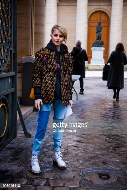 Caroline Daur wearing a Fendi jacket and black sweater is seen in the streets of Paris before the Ann Demeulemeester show during Paris Fashion Week...