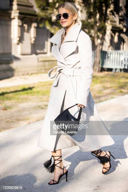 Caroline Daur wearing a grey coat black Prada bag and black heels is seen outside Elie Saab during Paris Fashion Week Haute Couture Spring/Summer...